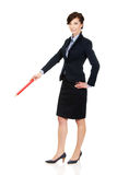 Businesswoman pointing down with pencil. Royalty Free Stock Photography