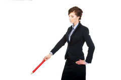 Businesswoman pointing down with pencil. Royalty Free Stock Image