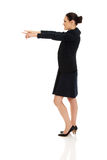 Businesswoman pointing on empty space. Royalty Free Stock Photos