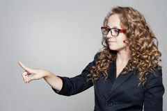 Businesswoman pointing on empty space Royalty Free Stock Photo