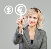 Businesswoman pointing on euro sign. Money transfers, exchange and banking concept.  stock images