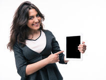 Businesswoman pointing finger on tablet computer screen Royalty Free Stock Photography
