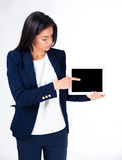 Businesswoman pointing finger on tablet computer screen Royalty Free Stock Photo