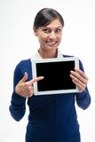 Businesswoman pointing finger on tablet computer screen Stock Photos