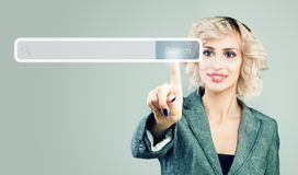 Businesswoman pointing finger to empty address bar with search icon in virtual web browser.  stock image