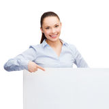 Businesswoman pointing finger to white blank board Royalty Free Stock Photos