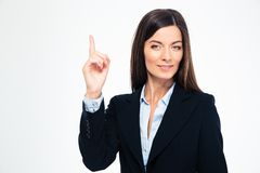 Businesswoman pointing finger up Stock Image