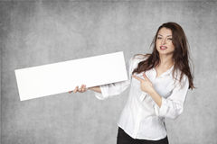 Businesswoman pointing a finger on your advertisement Royalty Free Stock Photo