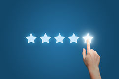 Businesswoman pointing five star to increase. stock photo