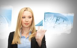 Businesswoman pointing at graph clock Stock Photography