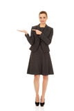 Businesswoman pointing on hand. Stock Photo