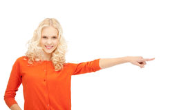 Businesswoman pointing her finger. Picture of attractive businesswoman pointing her finger Stock Photos