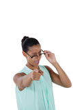 Businesswoman pointing her finger at the camera Stock Photo