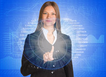 Businesswoman pointing her finger on glowing Stock Image