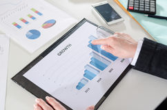 Businesswoman pointing her finger on a graph Stock Image