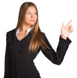 Businesswoman pointing her finger upward Royalty Free Stock Photos