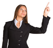 Businesswoman pointing her finger upward Royalty Free Stock Image