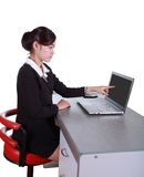 Businesswoman pointing at her laptop Stock Photo