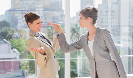 Businesswoman pointing at her rival Stock Photos