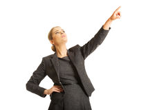 Businesswoman pointing high on copyspace Royalty Free Stock Photography