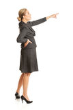Businesswoman pointing high on copyspace Stock Image
