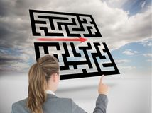 Businesswoman pointing at holographic maze Royalty Free Stock Image