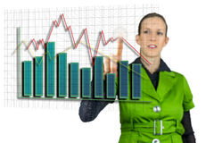 Businesswoman pointing at interactive business graph Royalty Free Stock Photos