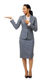 Businesswoman Pointing At Invisible Product Royalty Free Stock Photos