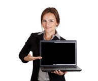 Businesswoman pointing on laptop Stock Photo