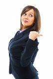 Businesswoman pointing. And looking over shoulder isolated on white background Royalty Free Stock Photo