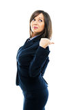 Businesswoman pointing. And looking over shoulder isolated on white background Stock Images