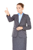 Businesswoman pointing and looking up Stock Images