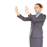 Businesswoman pointing and looking up Stock Photography