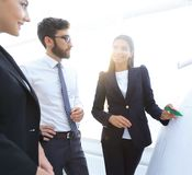Businesswoman pointing marker to flipboard on presentation in office Royalty Free Stock Image
