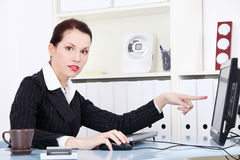 Businesswoman pointing on the monitor. Stock Photography