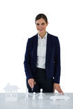 Businesswoman pointing on a paper cut out of family, car and house Royalty Free Stock Photo