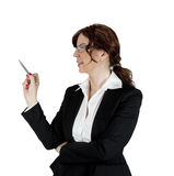 Businesswoman pointing with pen Royalty Free Stock Photos
