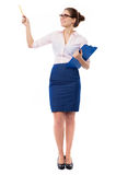 Businesswoman pointing with pen Stock Photo