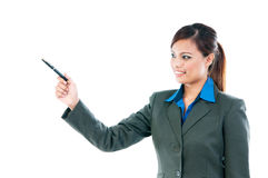 Businesswoman Pointing With Pen Royalty Free Stock Image