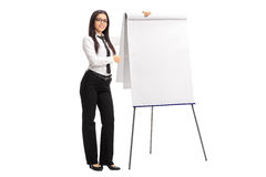 Businesswoman pointing on a presentation board Royalty Free Stock Photography