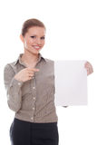 Businesswoman pointing showing empty billboard Stock Photo