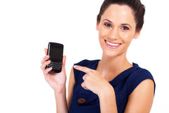 Businesswoman pointing at smart phone Royalty Free Stock Image