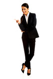 Businesswoman pointing on something. Smiling businesswoman pointing on something Stock Images