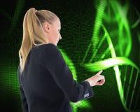 Businesswoman pointing somewhere Stock Photos