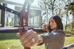 Businesswoman Pointing The Target With Bow And Arrow Stock Images