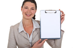 Businesswoman pointing to clip-board Stock Photos