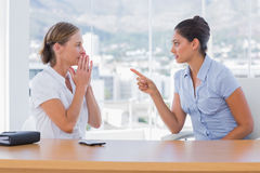 Businesswoman pointing to a colleague Stock Image