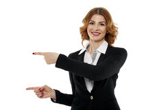 Businesswoman pointing to the copyspace Royalty Free Stock Photo