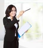 Businesswoman pointing to copyspace. Portrait of businesswoman pointing to copyspace Stock Image