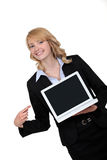 Businesswoman pointing to her laptop Royalty Free Stock Image